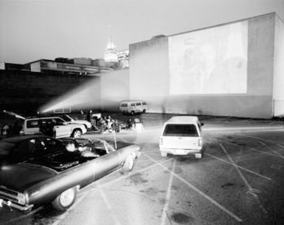 cars parked in lot watching film