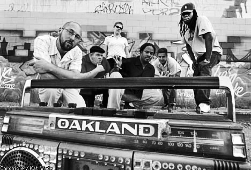 group of people behind a boombox that says Oakland